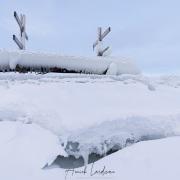 Ponton et ses barques gelés